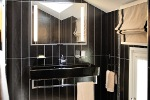 Interior design for the contemporary-style bathroom with mansard ceiling